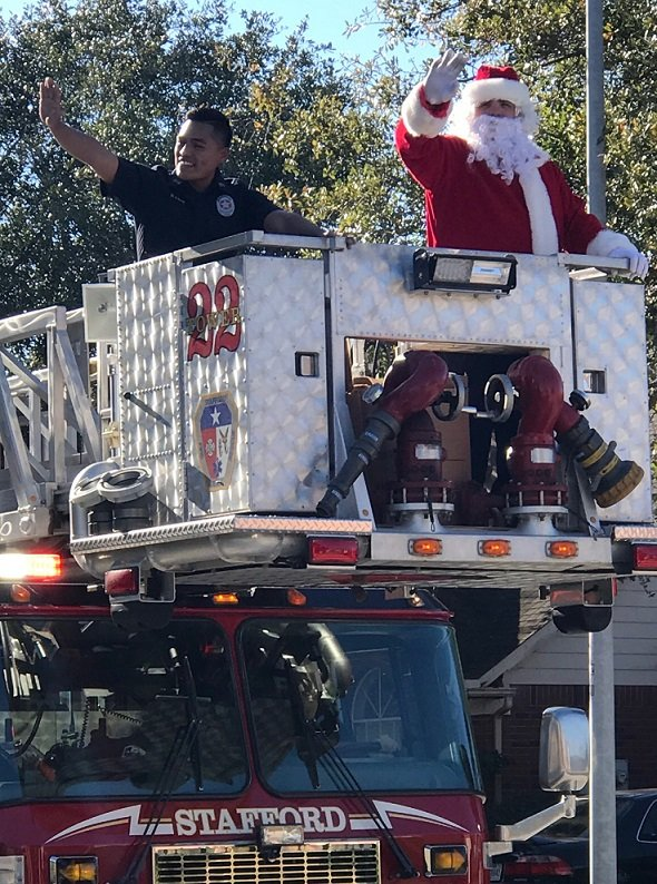 Santa Claus Comes To Town…..On A Ladder Tower